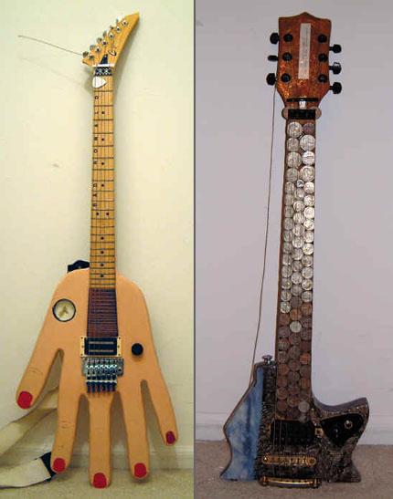 Bumblefoot_-_Big_Hand_Guitar,_Pensive_Expenguin_Guitar.jpg